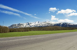 Road and snowy mountains Royalty Free Stock Photo