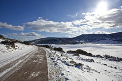 Road Through Snowy Mountains Royalty Free Stock Images