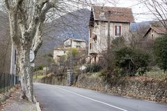 Road in Sospel in South of France. Street in Sospel. Plane trees stock images