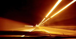 Road speed blur. Driving at night with road speed blur Royalty Free Stock Images