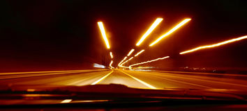 Road speed blur. Driving at night with road speed blur Stock Image