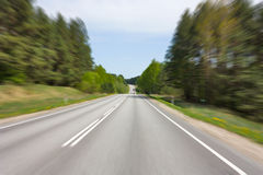 Road speed, blurred in motion Royalty Free Stock Images