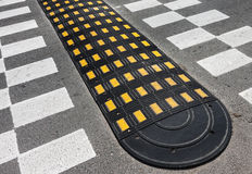 Road speed bump Stock Images