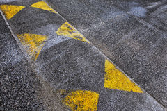 Road speed bump. A safety restriction to prevent people from fast driving Royalty Free Stock Image