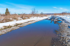 The road during the spring thaw with mud Royalty Free Stock Image