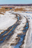 The road during the spring thaw with mud Stock Images