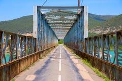 Road and steel bridge over reservoir Stock Image