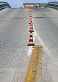 Road with a steep climb without cars with traffic cones Royalty Free Stock Photos