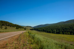 Road among the steppe and hills Stock Photo