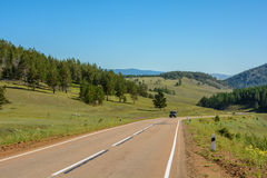 Road among the steppe and hills Royalty Free Stock Photos