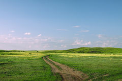 Road in steppe hills Royalty Free Stock Photography