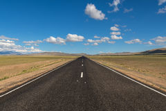 Road steppe mountains asphalt Royalty Free Stock Images