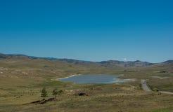 Road through the steppe. salt Lake. Royalty Free Stock Photos