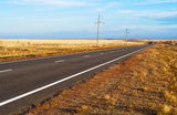 The road through the steppe. Way in asia. Panorama of the road to steppes (it is photographed at sunset Royalty Free Stock Photos