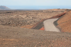 Road in stone desert Stock Photos
