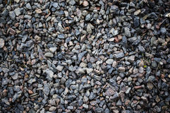 Road stone gravel texture to background. For your Stock Photography