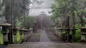 Road with stone lantern in the ancient Shinto shrine. The temple in the fog. Mitsumine. Japan. Chichibu. Saitama stock video footage