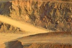 Road in stone quarry stock photos