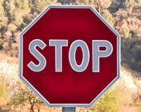 Road stop sign on blurred background. Stock Photo