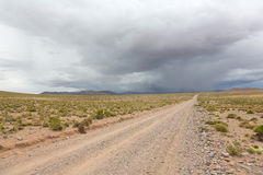 Road and storm clouds, Bolivia Stock Photos