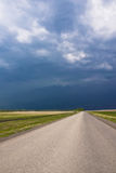 Road and the storm sky. Road and the storm blue sky Royalty Free Stock Photo