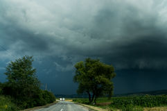 A road and storm sky Stock Photography
