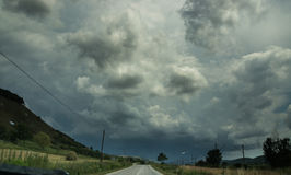 A road and storm sky Stock Images