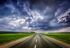 Road and stormy sky Stock Photography