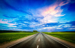 Road and stormy sky Stock Image