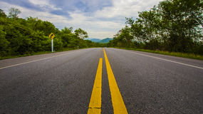 Road. Straight and empty road running to Mountain Royalty Free Stock Photos