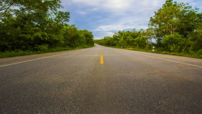 Road. Straight and empty road running to Mountain Royalty Free Stock Photo