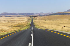 Road Straight. Road highway straight through the rural countryside landscape Stock Image