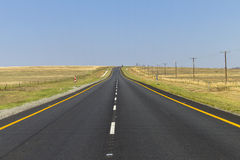 Road Straight. Road highway straight through the rural countryside landscape Royalty Free Stock Photography