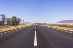 Road Straight. Road highway straight through the rural countryside landscape Royalty Free Stock Image