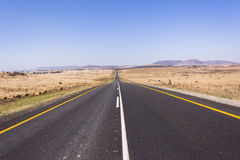 Road Straight. Road highway straight through the rural countryside landscape Royalty Free Stock Images