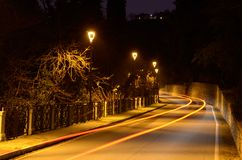 Road with street lamps Stock Photos