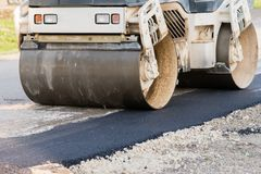 Road street repair with asphalt and roller. Vehicle Royalty Free Stock Photography