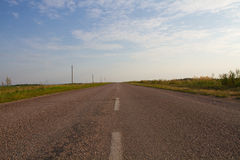 Road stretches into the distance Stock Images