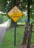 Flooding Road Sign. A sign warns motorist of an area of road subject to flooding Stock Photo
