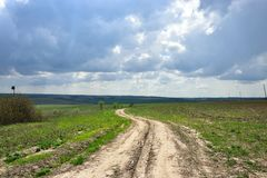Road. In summer day and clouds  sky Royalty Free Stock Photography