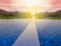 Road in summer forest at sunset. Road in summer forest at sunset Stock Photography
