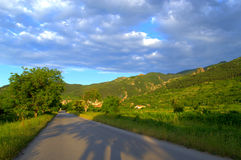 Road in summer lowland Stock Photo