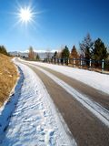 Road & The Sun. Shot of the sun shining on the road in a winter stock photo