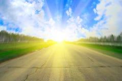 Road and sun Stock Photos