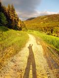Road at sundown with long shadow Stock Images