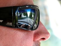 Road on sunglasses Stock Images