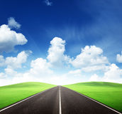 Road and sunny day Stock Image