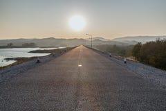 Road at sunrise Stock Photos