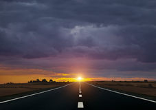 The road and sunrise Royalty Free Stock Photos