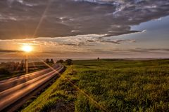 Road sunrise. Sunrise on the morning by the road in the field Royalty Free Stock Photography